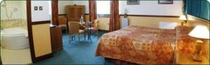 The Bedrooms at The Weigh Inn Hotel and Lodges