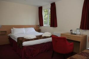 The Bedrooms at Heath Lodge Hotel