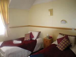 The Bedrooms at Halcyon Quest Hotel