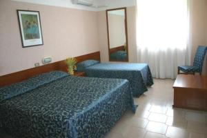 The Bedrooms at Centro Grotte Hotel