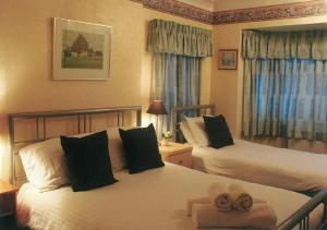 The Bedrooms at Acacia Guest House