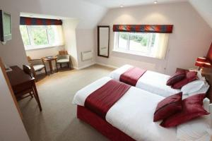 The Bedrooms at The Lodge At Meyrick Park Guest House