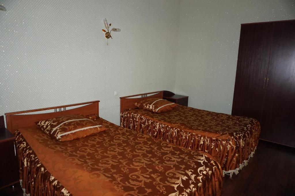 Двухместный (Двухместный номер Делюкс с 2 отдельными кроватями) мини-гостиницы Мини-отель Зодиак