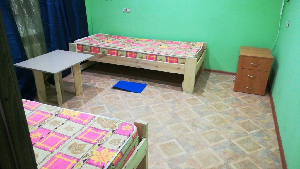 Двухместный (Двухместный номер с 2 отдельными кроватями и дополнительной кроватью) хостела Аметьево, Казань