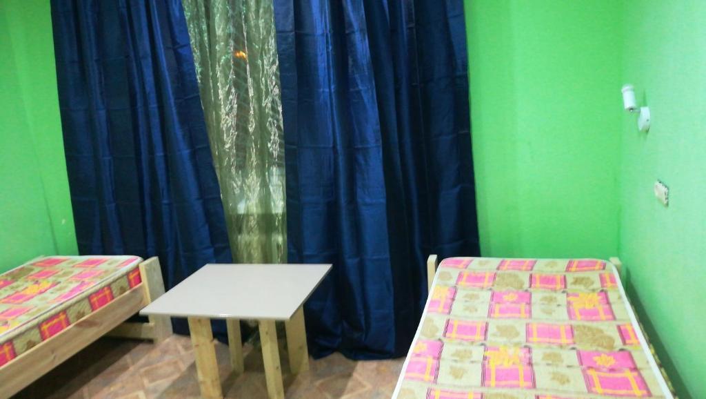 Двухместный (Двухместный номер с 2 отдельными кроватями и дополнительной кроватью)
