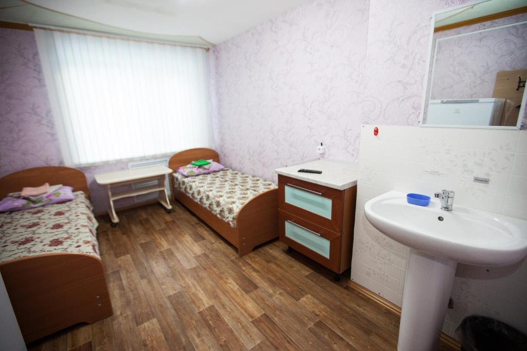 Двухместный (Бюджетный двухместный номер с 2 отдельными кроватями) гостиницы Турист