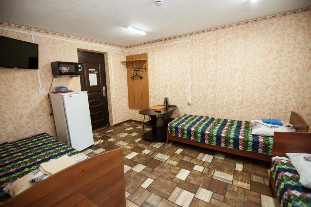 Номер (Односпальная кровать в мужском общем номере) гостиницы Турист
