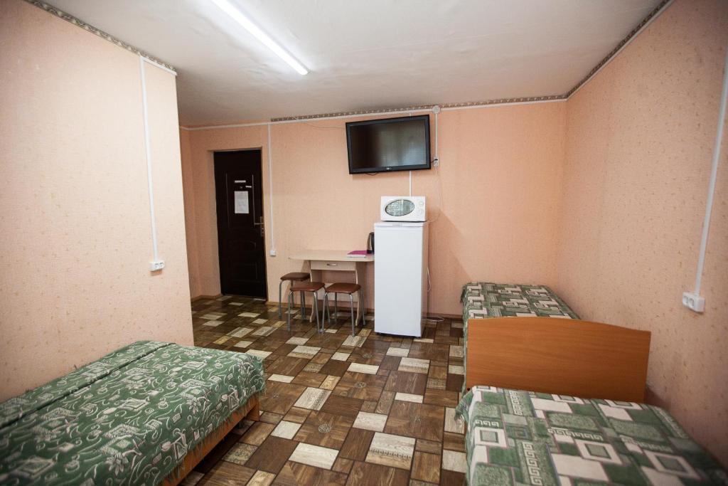 Номер (Односпальная кровать в общем номере) гостиницы Турист