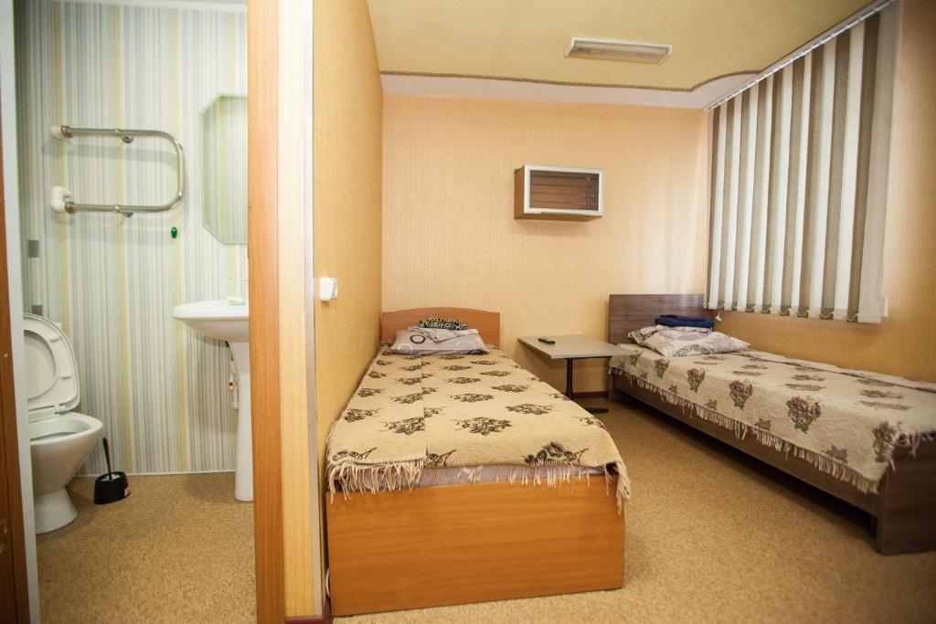 Двухместный (Двухместный номер эконом-класса с 2 отдельными кроватями) гостиницы Турист