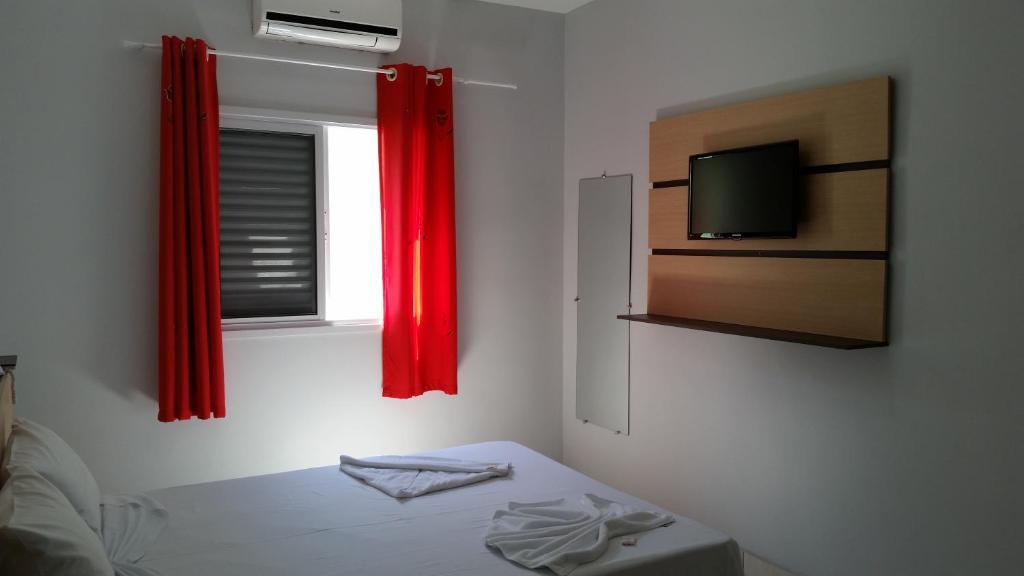 Отель Hotel Cavalo Marinho Suítes, Карагуататуба
