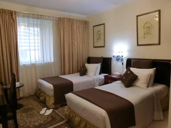 Al Muraqabat Plaza Hotel Apartments, Дубай, ОАЭ